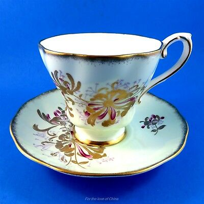 Pale Green Background with Gold Floral Design Royal Grafton Tea Cup and Saucer