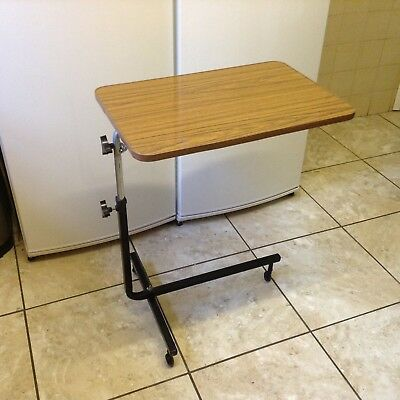 Over Bed  Table With Tilting Top And Adjustable Height.