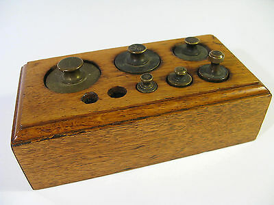 Antique Weight Set Housed in a Solid Oak Block.