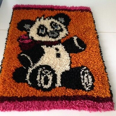 Handcrafted hooked panda bear for a wall hanging or rug
