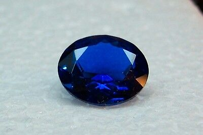 lab created one blue sapphire 9x11 oval excellent color and quality gemstones