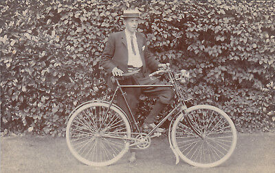 Unused postcard of a young man with a bicycle