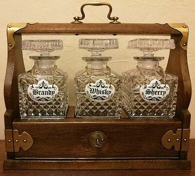 Tantalus Dark Oak & Brass fittings with 3 Glass Decanters & Decanter Labels