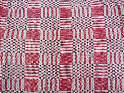 Vintage woven rust and black plaid coverlet