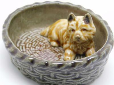 Wade of England Pottery Dog in Basket Collectable