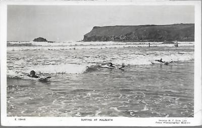 Polzeath, Cornwall - people surfing - RP postcard by Ellis of Bodmin c.1950s