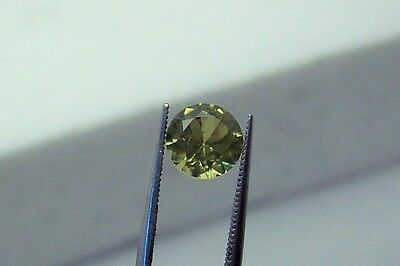 lab created stunning beautifully green sapphire 5.5 mm round faceted carat 0.60