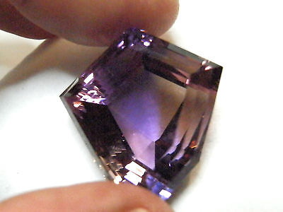 Natural earth-mined world class museum quality ametrine...77.02 carat