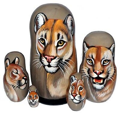 Cougar on Five Russian Nesting Dolls. Wild Life.