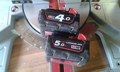 Milwaukee cordless chopsaw two batteries one 4 amp one 5 amp