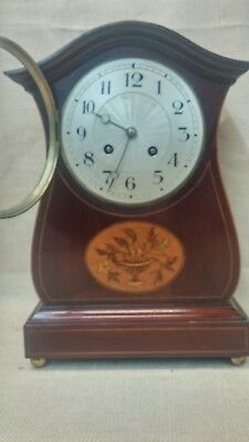 French Shelf Clock with Inlaid Design in Mahogany Case.