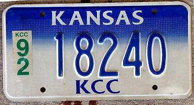Blue and White Kansas Commerce Commission License Plate with a 1992 Sticker