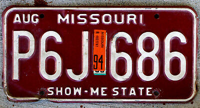 """White on Red Missouri License Plate with a 1994 Sticker """"Show-Me-State"""""""