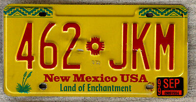 Red Green & Yellow New Mexico USA License Plate with a 1999 Sticker