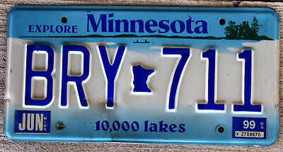 """Minnesota """"Canoe On Lake"""" License Plate with a 1999 Sticker"""