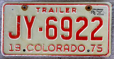 1975 Red on White Colorado Trailer License Plate with a 1976 Sticker