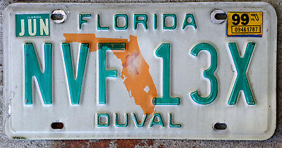 Florida Orange State Outline License Plate DUVAL County with a 1999 Sticker