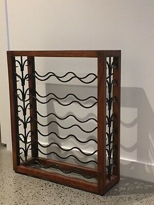 wooden and wrought iron wine rack