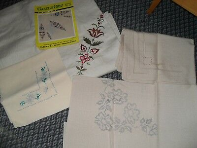 5 partly worked embroidered linens/table cloths