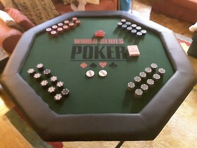 World Series folding octagonal Poker table with poker chips.