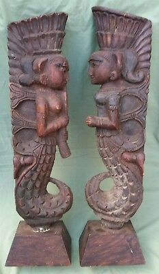 Pair of Indonesian carved wood Posts depicting Figures.  Architectural