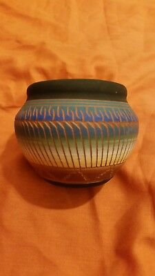 navajo pottery squat vase. Signed P. Etoitty Dire 02' painted and etched.