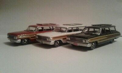 1/64 AutoWorld 1965 Ford Country Squire Station Wagons (lot of 3)