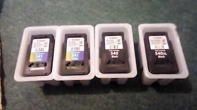 Four (4) Canon black and tricolour cartridges - empty, for refilling