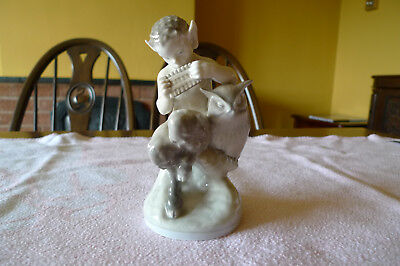 Royal Copenhagen scarce model of a Faun seated with pipes and an owl No 2107