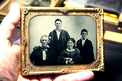 Ambrotype 1/2 plate of a familly tinted cheeks no case