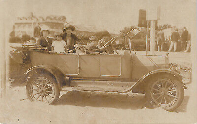 1927 postcard of a family sat in a car / automobile on Yarmouth Sands
