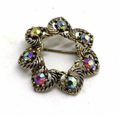Vintage brooch with gems on golden and silver tones metal
