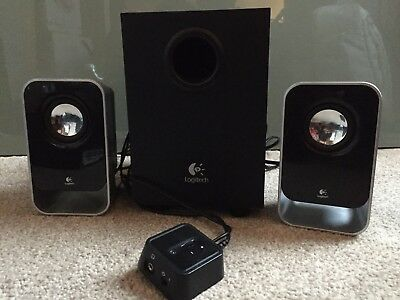 Logitech LS21 2.1 Stereo Speaker System - Two speakers and a subwoofer