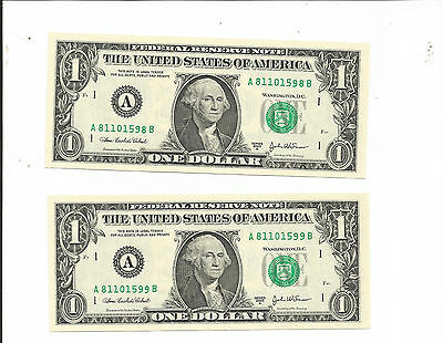a pair of $1 frn. 2003-A. Serial number bleed through.! CRISP UNC.!!