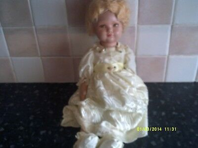 Antique Bisque headed doll with a felt body