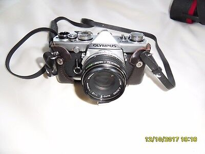 Olympus OM1n with 50mm Zuiko 1:1.8 50mm lens with extras and case.
