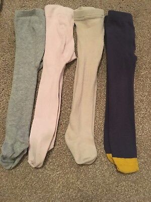 Four Pairs Girls Tights Size 6-12 Months