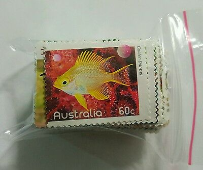 100x UNFRANKED UNCANCELLED mixed VALUE Australian Stamps with $60 FV.