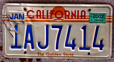California Golden Sunrise License Plate with a 2002 Sticker