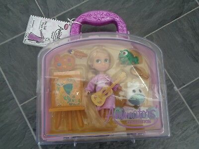 BNIB disney store-rapunzel animator playset- rapunzel doll,pascal+accessories