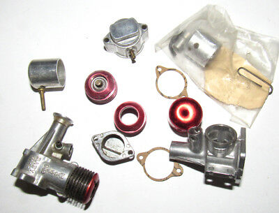 ASSORTED PARTS FOR McCOY GLOW MODEL AIRPLANE ENGINES