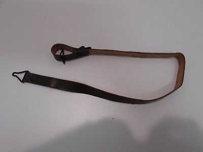 WWII US M-1 brown leather helmet strap that connects helmet to liner.