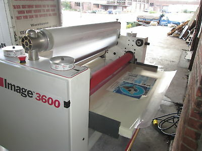 "SEAL Image 3600 Laminator mounting and laminating prints up to 38"" wide"