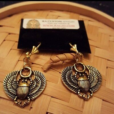 Antique Gold Scarab earrings with Antique Gold lead free lever backs ear wires.