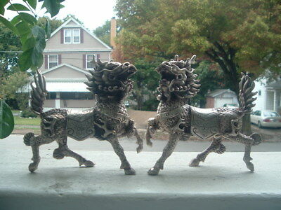 Chinese silver kylin foo dog evil beast lion statues pair