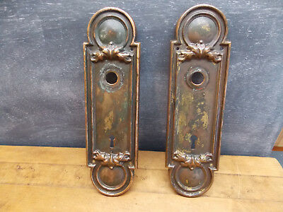 Pair of old brass escutcheon door knob plates key hole