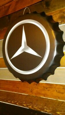 Mercedes embossed metal sign.