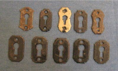 group of 10 assorted vintage cast iron escutcheons key hole cover plate