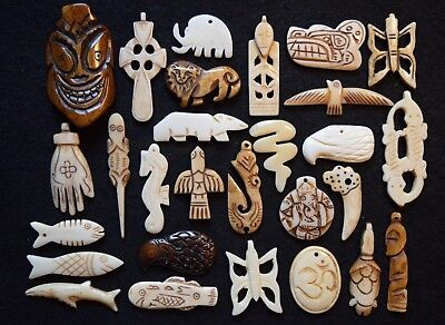 28  different hand carved bone beads/pendants artistic objects