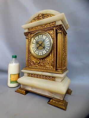 A GOOD JAPY FRERES GONG STRIKE ARMORIAL ALABASTER AND GILDED MANTLE CLOCK c1880